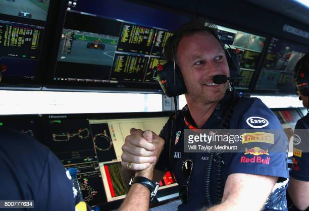 Red Bull Racing Team Principal Christian Horner celebrates the victory of Daniel Ricciardo of Australia and Red Bull Racing on the pit wall during...