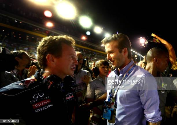 Red Bull Racing Team Principal Christian Horner chats with David Beckham on the grid during the Singapore Formula One Grand Prix at Marina Bay Street...