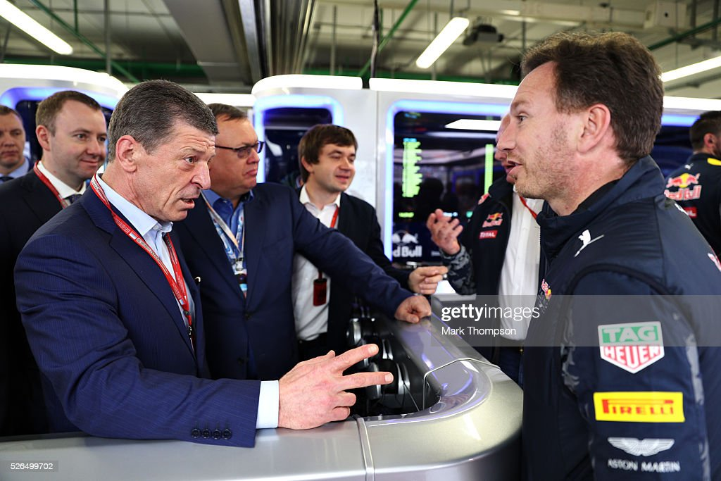 Red Bull Racing Team Principal Christian Horner in the garage with Dmitry Kozak, Deputy Prime Minister of Russia, during qualifying for the Formula One Grand Prix of Russia at Sochi Autodrom on April 30, 2016 in Sochi, Russia.