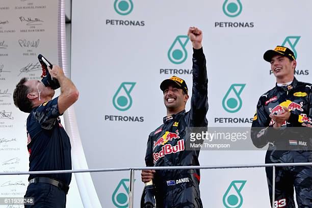 Red Bull Racing Team Principal Christian Horner performs a shooey on stage with Daniel Ricciardo of Australia and Red Bull Racing and Max Verstappen...
