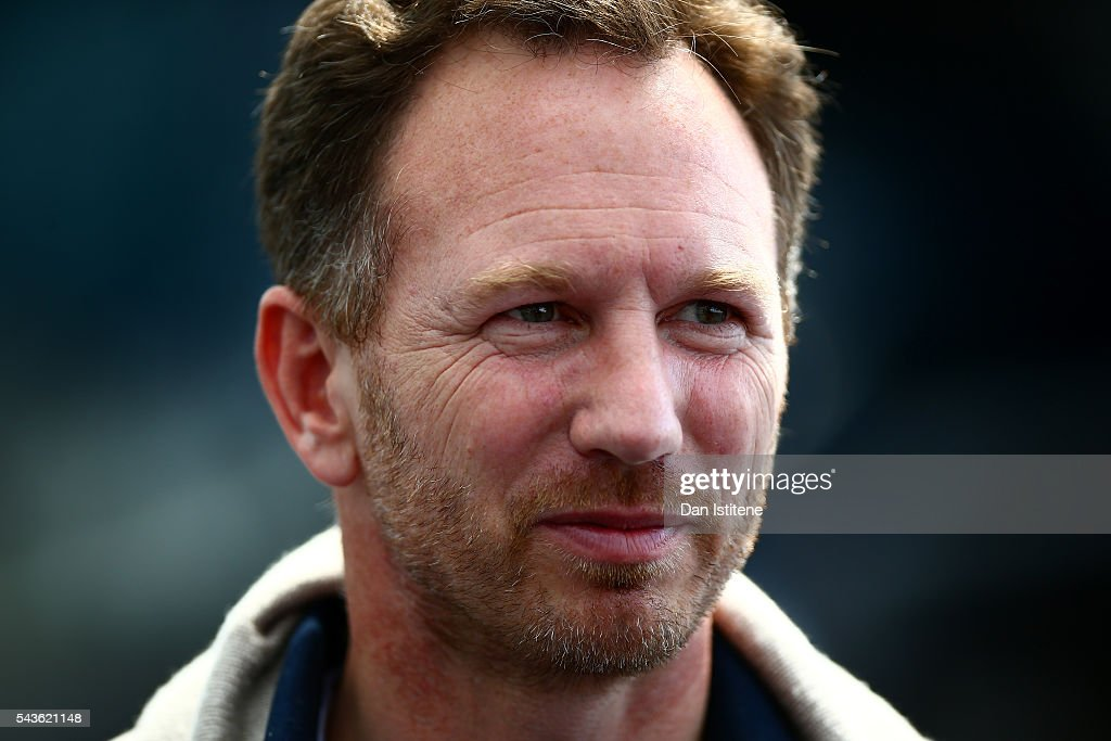 Red Bull Racing Team Principal Christian Horner speaks with members of the media after a Red Bull Racing media flight to Hangar 7 on June 29, 2016 in Salzburg, Austria.