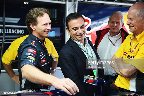 Red Bull Racing Team Principal Christian Horner talks with Carlos Ghosn the Renault Chairman before the Brazilian Formula One Grand Prix at the...
