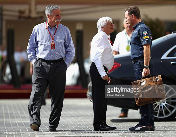 Red Bull Racing Team Principal Christian Horner talks with F1 supremo Bernie Ecclestone in the Paddock next to Chase Carey Chairman of Formula One...
