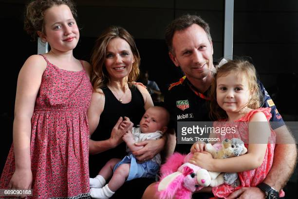 Red Bull Racing Team Principal Christian Horner with his wife Geri Horner and their children Bluebell Montague and Olivia in the Paddock before the...