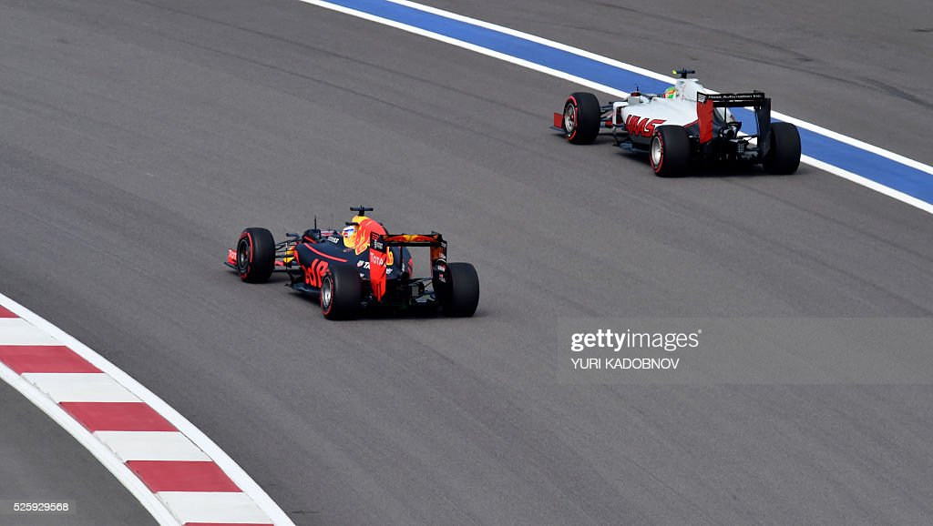 Red Bull Racing's Australian driver Daniel Ricciardo (C) and Haas F1 Team's Mexican driver Esteban Gutierrez steer their cars during the first practice session of the Formula One Russian Grand Prix at the Sochi Autodrom circuit on April 29, 2016. / AFP / YURI