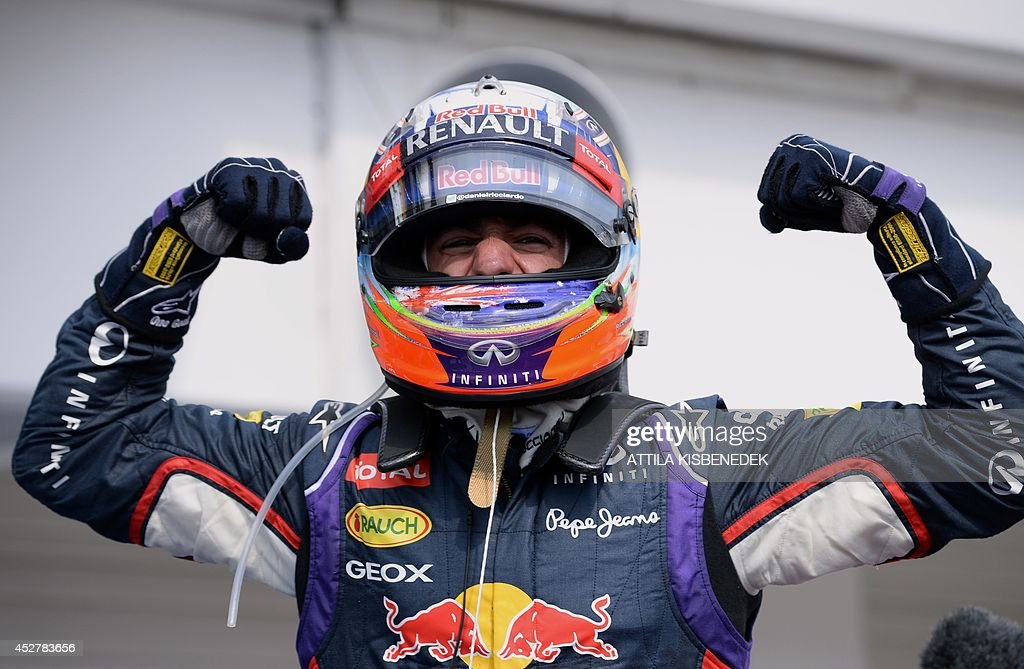 Red Bull Racing's Australian driver Daniel Ricciardo celebrates after the Hungarian Formula One Grand Prix at the Hungaroring circuit in Budapest on July 27, 2014. Red Bull Racing's Australian driver Daniel Ricciardo won the race ahead of Scuderia Ferrari's Spanish driver Fernando Alonso (2nd) and Mercedes' British driver Lewis Hamilton (3rd).