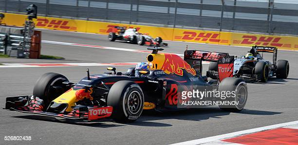 Red Bull Racing's Australian driver Daniel Ricciardo leads Sahara Force India F1 Team's Mexican driver Sergio Perez during the Formula One Russian...
