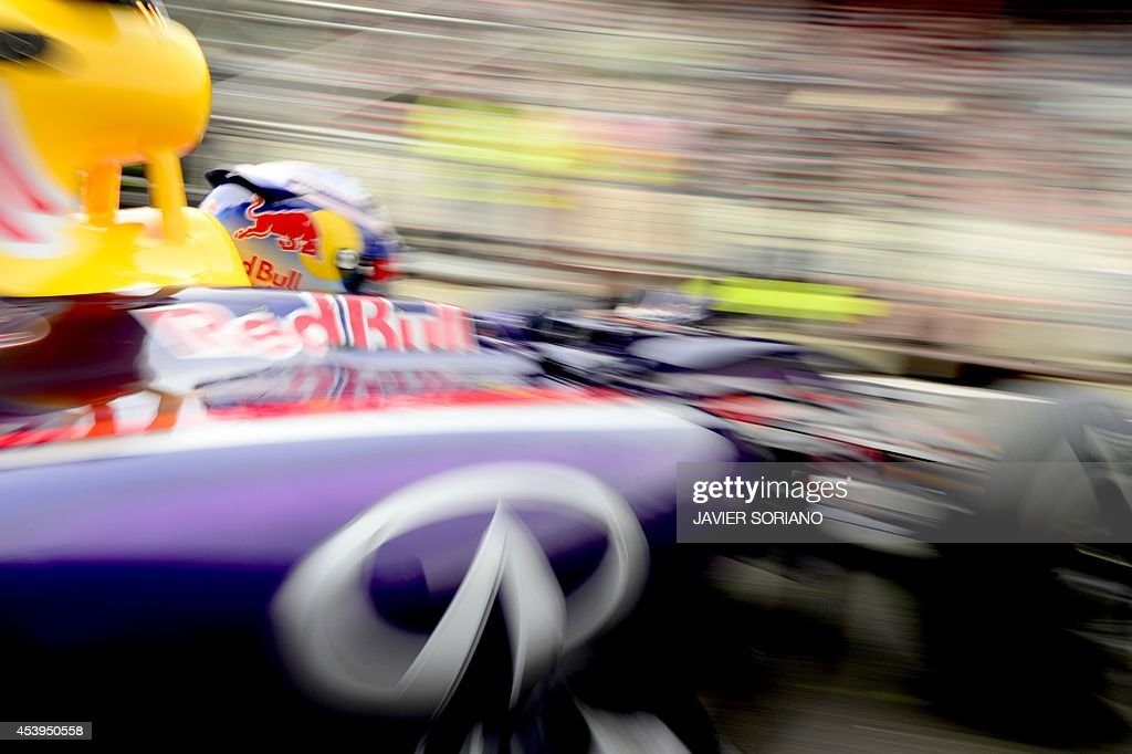 Red Bull Racing's Australian driver Daniel Ricciardo leaves the pits during the first practice session at the Spa-Francorchamps circuit in Spa on August 22, 2014 ahead of the Belgium Formula One Grand Prix. AFP PHOTO / TOM GANDOLFINI