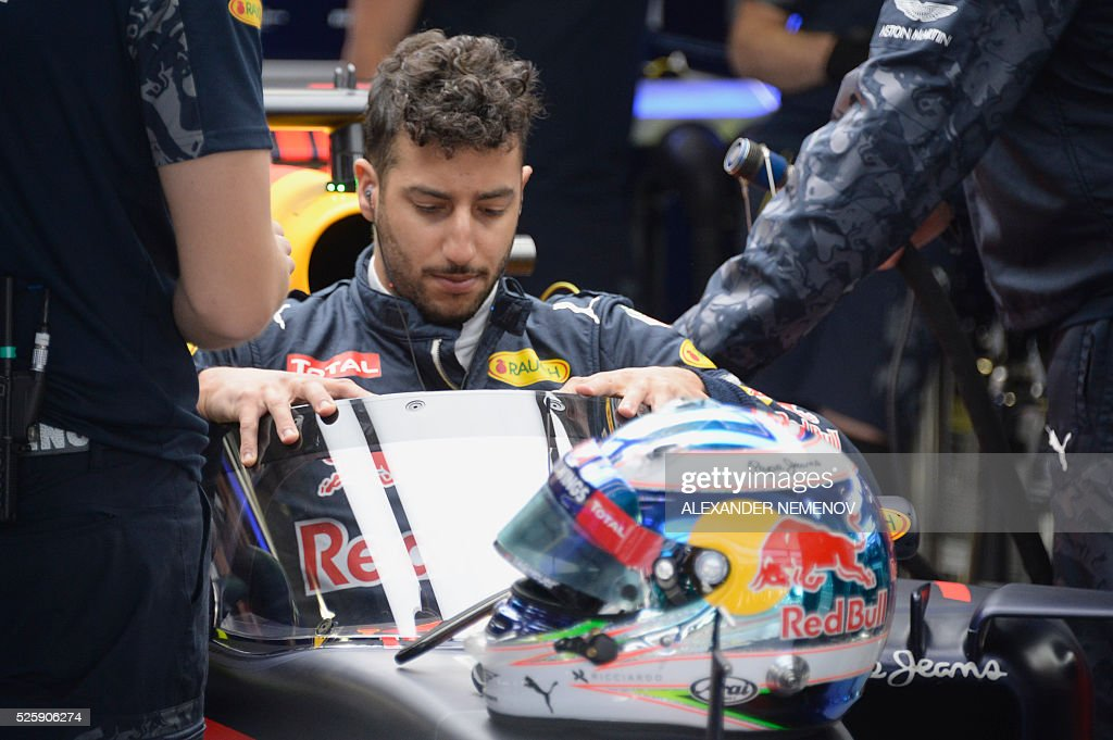 Red Bull Racing's Australian driver Daniel Ricciardo sits in his car during the first practice session of the Formula One Russian Grand Prix at the Sochi Autodrom circuit on April 29, 2016. / AFP / ALEXANDER