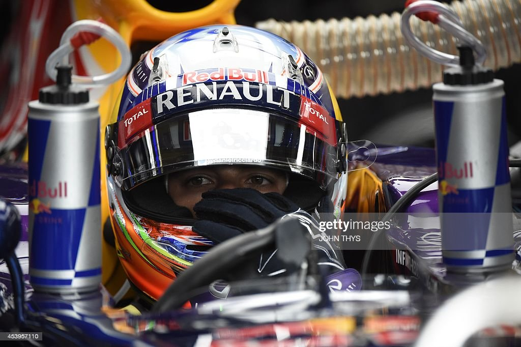 Red Bull Racing's Australian driver Daniel Ricciardo sits in the pits during the second practice session at the Spa-Francorchamps circuit in Spa on August 22, 2014 ahead of the Belgium Formula One Grand Prix. AFP PHOTO / JOHN THYS