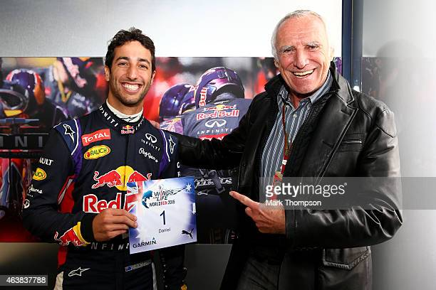 Red Bull Racing's driver Daniel Ricciardo of Australia receiving bib number 1 for the 'Wings of Live World Run' from team owner CEO of the Austria...