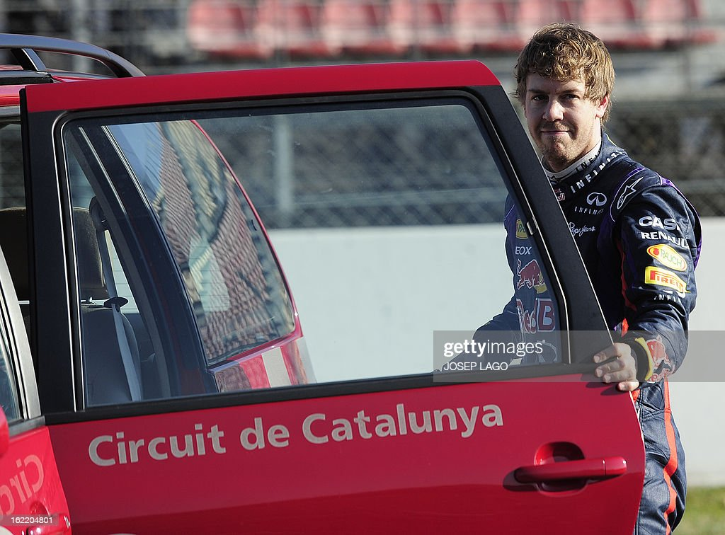 Red Bull Racing's German driver Sebastian Vettel leaves the racetrack after his car broke down during the second day of Formula One testing at the Catalunya racetrack in Montmelo, near Barcelona, on February 20, 2013.