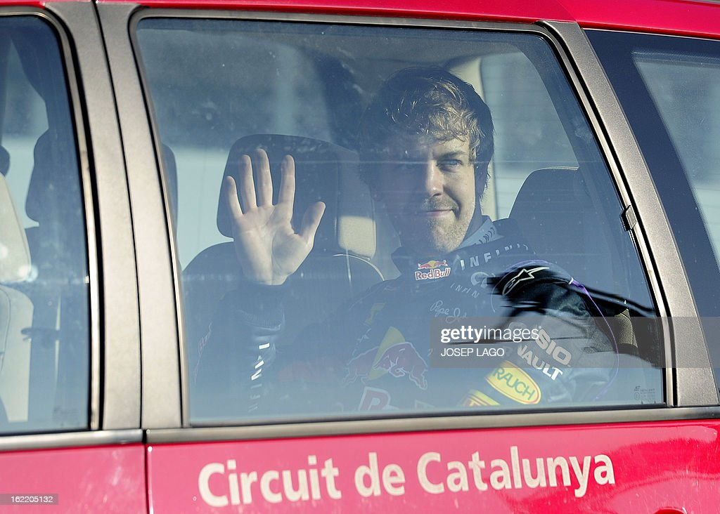 Red Bull Racing's German driver Sebastian Vettel leaves the racetrack after his car broke down during the second day of Formula One testing at the Catalunya racetrack in Montmelo, near Barcelona, on February 20, 2013. AFP PHOTO / JOSEP LAGO