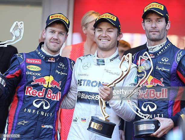 Red Bull Racing's German driver Sebastian Vettel Mercedes' German driver Nico Rosberg and Red Bull Racing's Australian driver Mark Webber celebrate...