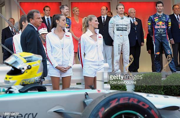Red Bull Racing's German driver Sebastian Vettel Mercedes' German driver Nico Rosberg Red Bull Racing's Australian driver Mark Webber celebrate in...