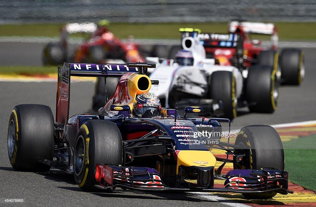 Red Bull Racing's German driver Sebastian Vettel, Williams' Finnish driver Valtteri Bottas, Ferrari's Spanish driver Fernando Alonso and Ferrari's Finnish driver Kimi Raikkonen drive at the Spa-Francorchamps ciruit in Spa on August 24, 2014 during the Belgium Formula One Grand Prix.