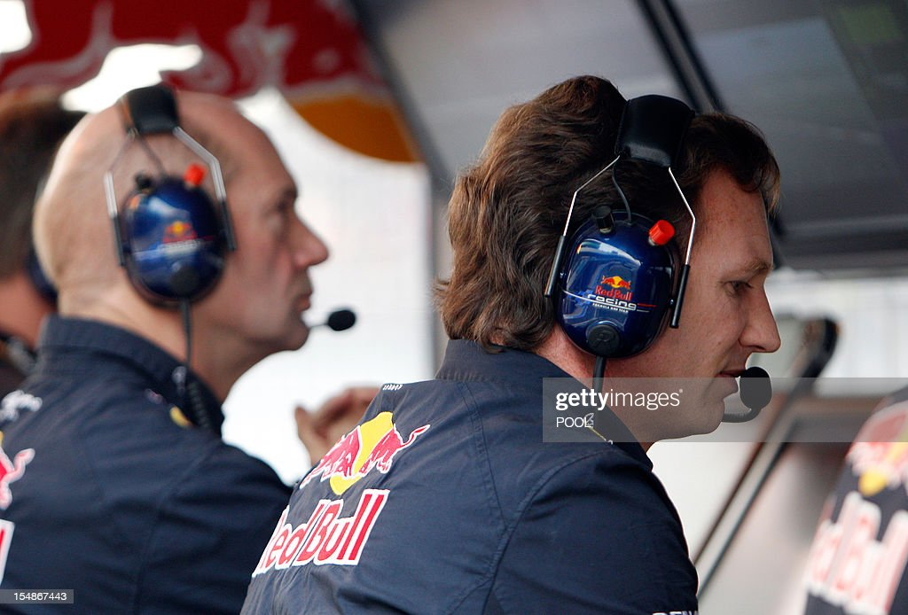 Red Bull team principal Christian Horner (R) and team designer Adrian Newey watch from the pit wall during the Indian Formula One Grand Prix 2012 at the Buddh International Circuit in Greater Noida on the outskirts of New Delhi on October 28, 2012. AFP PHOTO/Greg Baker/POOL