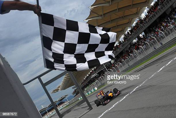 Red BullRenault driver Sebastian Vettel of Germany passes the finish line during Formula One's Malaysian Grand Prix in Sepang on April 4 2010...