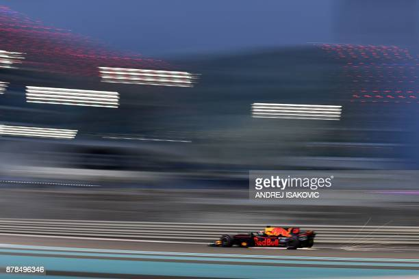 Red Bull's Australian driver Daniel Ricciardo drives during the second practice session ahead of the Abu Dhabi Formula One Grand Prix at the Yas...