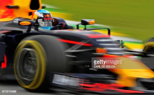 TOPSHOT Red Bull's Australian driver Daniel Ricciardo powers his car during the Brazilian Formula One Grand Prix practice session at the Interlagos...