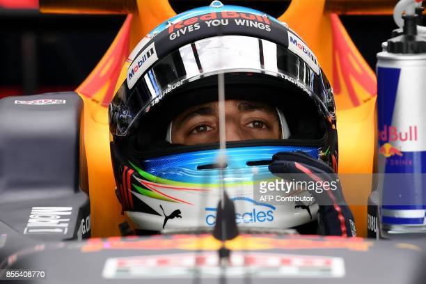 Red Bull's Australian driver Daniel Ricciardo prepares to drive out of the pit during the second practice session of the Formula One Malaysia Grand...