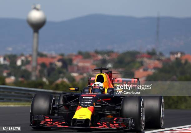 Red Bull's Australian driver Daniel Ricciardo races during a free practice session at the Hungaroring racing circuit in Budapest on July 29 2017...