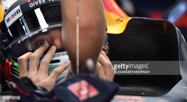Red Bull's Australian driver Daniel Ricciardo sits in his car during the first practice session of the Formula One Russian Grand Prix at the Sochi...
