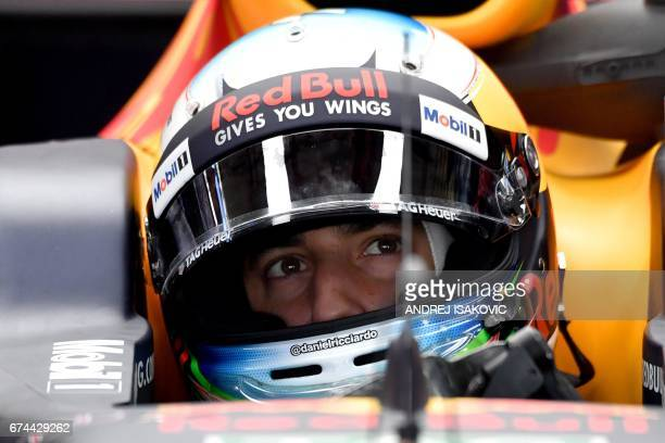 Red Bull's Australian driver Daniel Ricciardo sits in his car during the second practice session of the Formula One Russian Grand Prix at the Sochi...