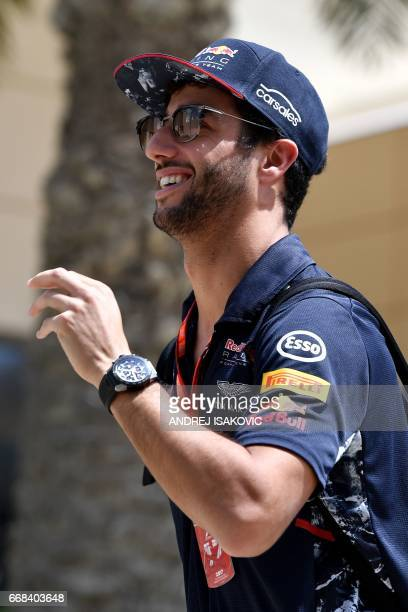 Red Bull's Australian driver Daniel Ricciardo walks to the paddock ahead of the Formula One Bahrain Grand Prix at the Sakhir circuit in the desert...
