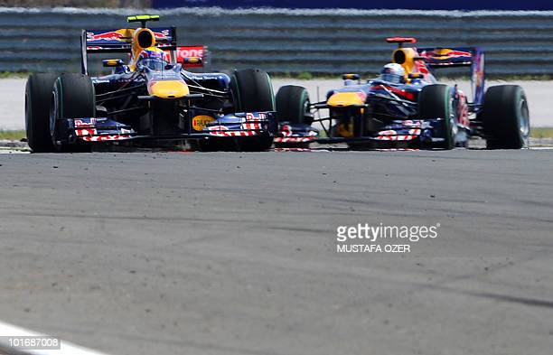 Red Bull's Australian driver Mark Webber drives ahead of Red Bull's German driver Sebastian Vettel at the Istanbul Park circuit on May 30 during the...