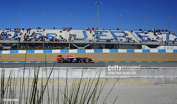 Red Bull's Australian driver Mark Webber steers his Formula One during the second day of testing at Jerez racetrack on February 6 2013 in Jerez de la...