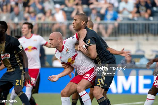 Red Bulls D Aurélien Collin and Union D Oguchi Onyewu battle for position on a free kick in the first half during the game between the New York Red...