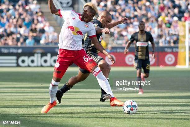 Red Bulls D Michael Murillo reaches around Union D Fabinho in the first half during the game between the New York Red Bulls and Philadelphia Union on...