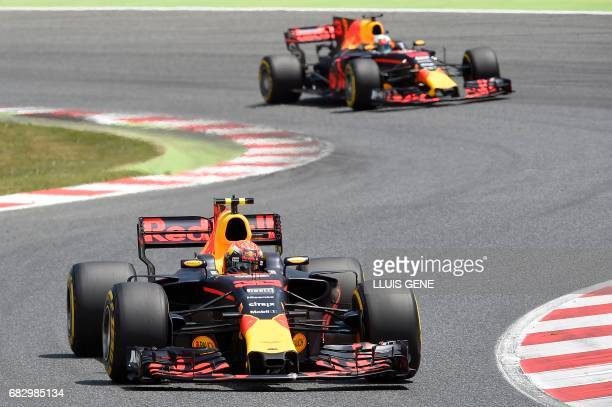 Red Bull's Dutch driver Max Verstappen and Red Bull's Australian driver Daniel Ricciardo race at the Circuit de Catalunya on May 14 2017 in Montmelo...