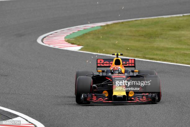 Red Bull's Dutch driver Max Verstappen drives during the third practice session of the Formula One Japanese Grand Prix at Suzuka on October 7 2017 /...