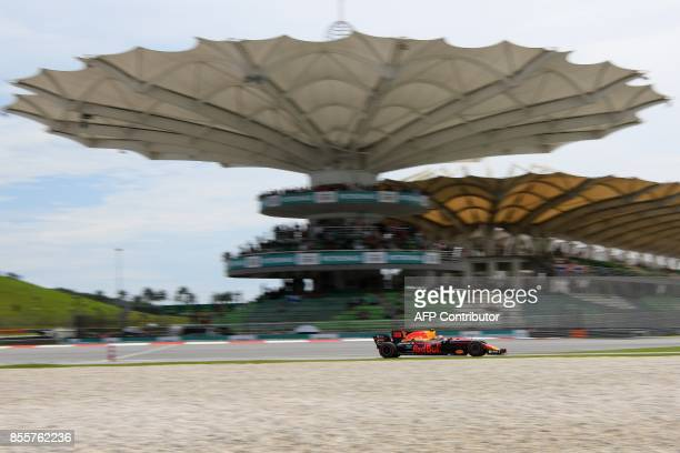 Red Bull's Dutch driver Max Verstappen drives his car during the third practice session of the Formula One Malaysia Grand Prix in Sepang on September...