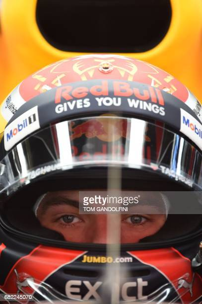 Red Bull's Dutch driver Max Verstappen looks at a screen in the pits during the first practice session at the Circuit de Catalunya on May 12 2017 in...