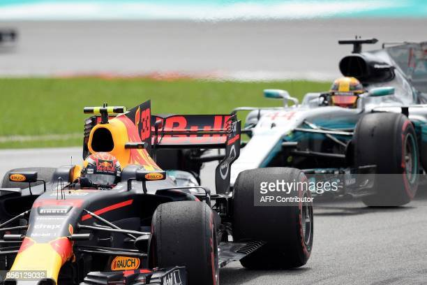 Red Bull's Dutch driver Max Verstappen overtakes Mercedes' British driver Lewis Hamilton during the Formula One Malaysia Grand Prix in Sepang on...