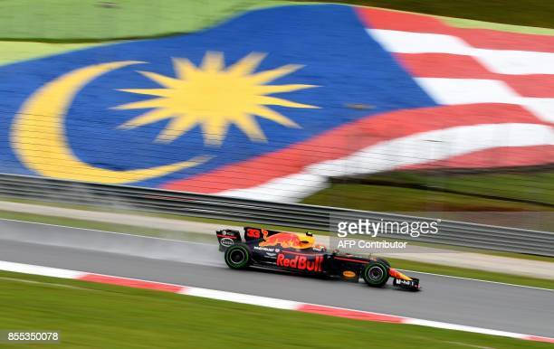 Red Bull's Dutch driver Max Verstappen powers his car during the first practice session of the Formula One Malaysia Grand Prix in Sepang on September...