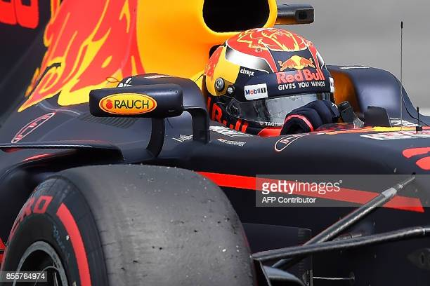 Red Bull's Dutch driver Max Verstappen powers his car during the third practice session of the Formula One Malaysia Grand Prix in Sepang on September...