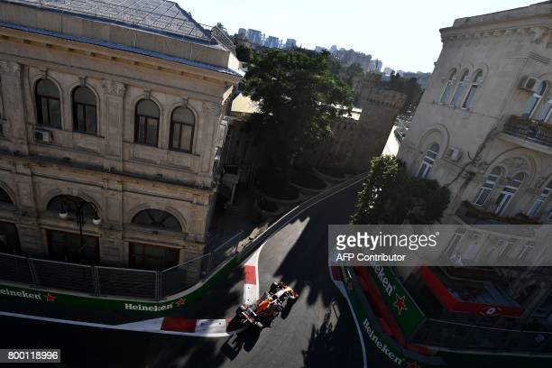 Red Bull's Dutch driver Max Verstappen steers his car during the second practice session of the Formula One Azerbaijan Grand Prix at the Baku City...