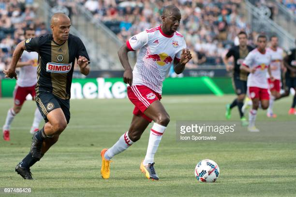 Red Bulls Forward Bradley WrightPhillips carries the ball past Union D Fabinho in the first half during the game between the New York Red Bulls and...