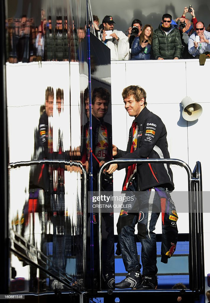 Red bull's German driver Sebastian Vettel arrives in the pits during the third day of Formula One testing at Jerez racetrack, on February 7, 2013 in Jerez de la Frontera.