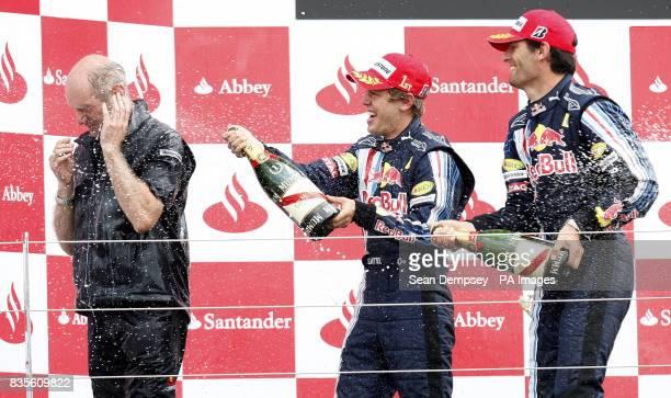 Red Bull's Sebastian Vettel celebrates with team mate Mark Webber and car designer Andrian Newey during the British Grand Prix at Silverstone...