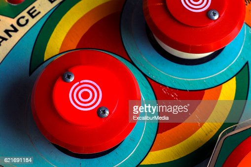 Red bumpers on a retro pinball machine : Stock Photo
