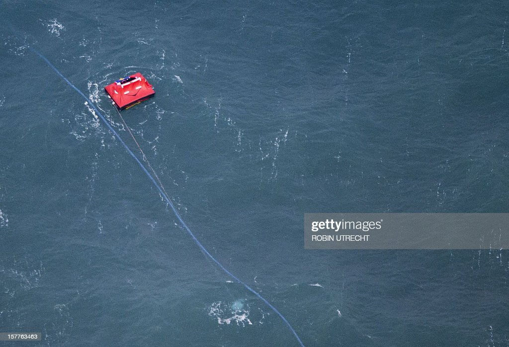 A red buoy marks the spot where the cargo ship 'Baltic Ace' sunk, during a search and rescue operation for crewmembers of the sunken cargo-vessel during a rescue operation on December 6 in the North Sea. Dutch sea rescue services launched a major rescue operation for 11 missing sailors after two ships collided in a busy North Sea shipping lane off the coast of Rotterdam with one ship sinking. Rescuers, including the Dutch navy, on December 5, plucked 13 survivors from the water after the Baltic Ace car carrier collided with the Corvus J container ship about 100 kilometres (60 miles) southwest of Rotterdam. A Belgian sea rescue helicopter found another body this morning, the coastguard said, bringing the confirmed death toll to five. Late on December 6 Dutch coastguards called off a search for six crew still missing after their cargo ship sank in the North Sea, saying there was 'zero' chance of finding survivors in the icy waters.AFP PHOTO / ANP / ROBIN UTRECHT