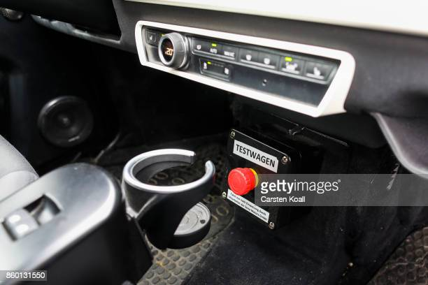 A red button marks the testcar of a Sono Motors Sion solarpowered electric car during a presentation event on October 11 2017 in Berlin Germany...