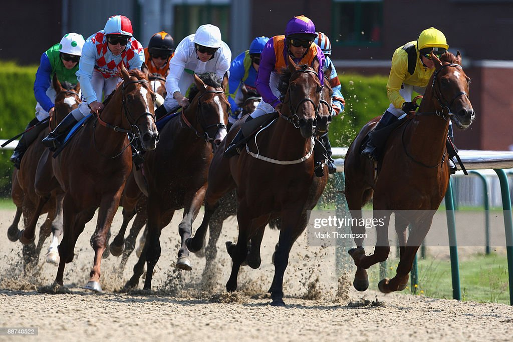 Red Cadeaux riden by Seb Sanders on their way to winning the Bet Wimbledon TennisBetdaq Stakes race at Dunstall Park on on June 29 2009 in...
