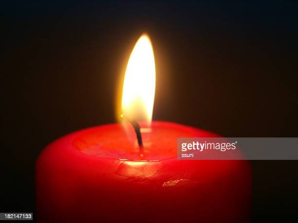 Red candle on a white background