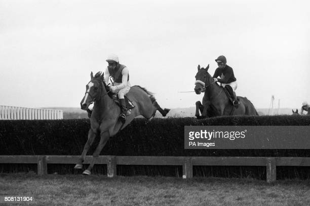 Red Candle ridden by Jimmy Fox heads to victory in the Hennessy Cognac Gold Cup at Newbury Red Rum ridden by Brian Fletcher is close behind